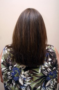 A Brazilian blowout would make Debbie's hair silky smooth and easy to blow out with the blowdryer in half the time.